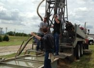 Monitoring Well Drillers Working in the Field